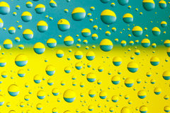 Water drops above ukrainian flag Royalty Free Stock Photos
