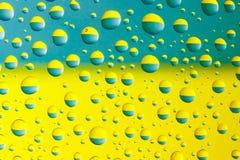 Water drops above ukrainian flag. Many water drops above ukrainian colors, blue and yellow Royalty Free Stock Photos