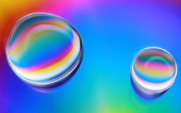 Water drops abstract background. A close up photo of water drops on a cd with a rainbow background stock photos