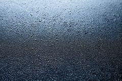 Water drops abstract dark background Stock Photography