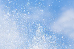 Water drops in the air on the sky. Stock Photo