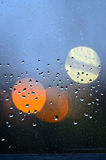 Water drops of an april shower on a dirty pane of glass Stock Photos