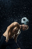 Water drops around football player royalty free stock photos