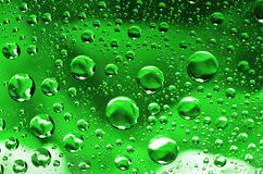 Water drops background on green surface. Water droplets with ref Royalty Free Stock Photo