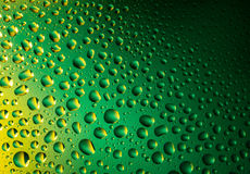 Water drops. Background. Green and yellow abstract and creative background. 3D  close-up royalty free stock images