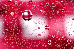 Water drops background on red surface. Water droplets with refle Stock Image