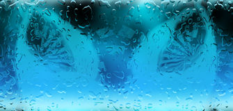 Water drops bakground. Wet glass, water drops pattern on transparent blue glass Royalty Free Stock Images