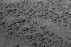 Water drops. On black background Royalty Free Stock Photos