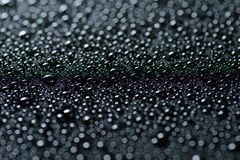 Water drops on black Royalty Free Stock Photography