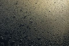 Water drops on black background abstract texture background. gol. Den light Royalty Free Stock Photography