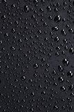 Water drops on a black plastic surface Royalty Free Stock Image