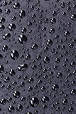 Water drops on a black plastic surface Stock Photo