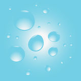 Water drops on blue Stock Photos