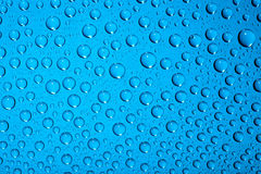 Water drops on blue Royalty Free Stock Photo