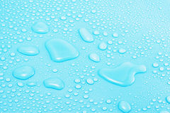 Water Drops on Blue Stock Photography