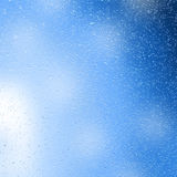 Water drops on blue background Stock Images