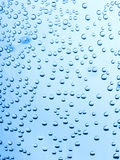 Water drops on a blue background Royalty Free Stock Photos