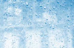 Water drops blue background Royalty Free Stock Image