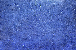 Water drops on blue background Stock Photo