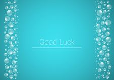 Water drops on blue background with Good Luck text Stock Image