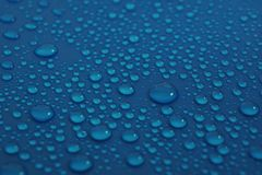 Water drops on blue background texture. Pure drops of ecology protection of water resources, the preservation of fresh water royalty free stock photo
