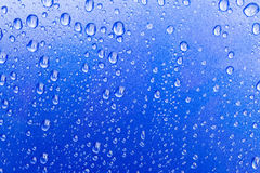 Water drops on blue Stock Images