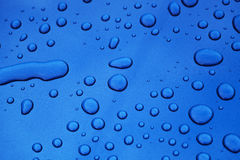 Water drops on blue car body threated with protective coating Stock Photography