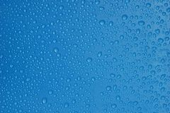 Water Drops Blue Color Texture Background Close-up. Royalty Free Stock Images