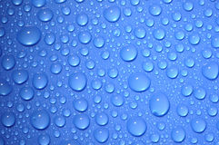 Water drops on blue glass Royalty Free Stock Photo