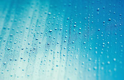Water drops and blue sky Stock Images