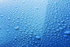 Water drops on blue surface Royalty Free Stock Image