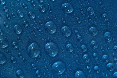 Water drops on the blue surface Royalty Free Stock Photography