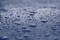 Water drops on blue surface. Royalty Free Stock Image