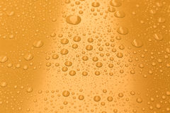 Water drops on bright yellow background Royalty Free Stock Images