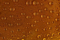 Water drops on the brown surface Royalty Free Stock Image