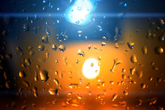 Water drops with candle light Stock Images
