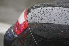 Water drops on car. Water drops on black car surface Stock Photo