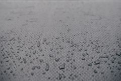 Water drops on car carbon. Dark wallpaper royalty free stock photos