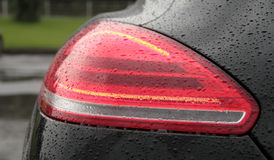 Water drops on car rear lights after anti rain protection coating stock photos Royalty Free Stock Photos