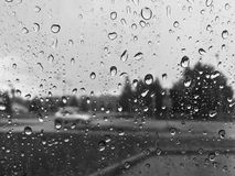 Water drops on car window in rainy day Royalty Free Stock Photos