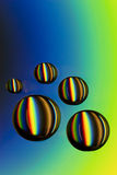 Water drops on CD with colorful rainbow Stock Photography