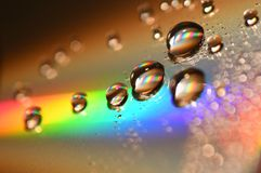 Water Drops on CD and DVD. abstract wallpaper. Royalty Free Stock Photos