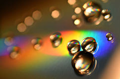 Water Drops on CD and DVD. abstract wallpaper. Water Drops on CD and DVD. Colorful background Royalty Free Stock Images