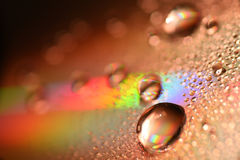 Water Drops on CD and DVD. abstract wallpaper. Water Drops on CD and DVD. Colorful background Royalty Free Stock Image