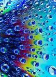 Water drops on CD dvd. Water drops on CD macro rainbow dvd Stock Photos