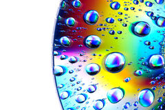 Water drops on CD dvd. Water drops on CD macro rainbow dvd Royalty Free Stock Photography