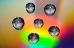 Water drops on cd surface Stock Photos