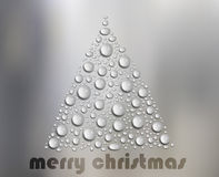 Water Drops Christmas Tree on White Glass Royalty Free Stock Photography