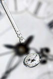 Water drops on clock face Stock Images