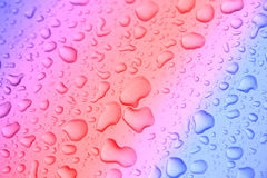 Water drops. Close view of water drops on colored background Royalty Free Stock Photos